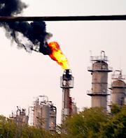 Caption: The Texas Petrochemicals flare., Credit: Bryan Parras