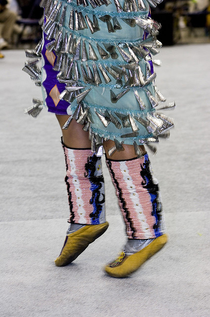 Caption: A woman dances in her jingle dress.