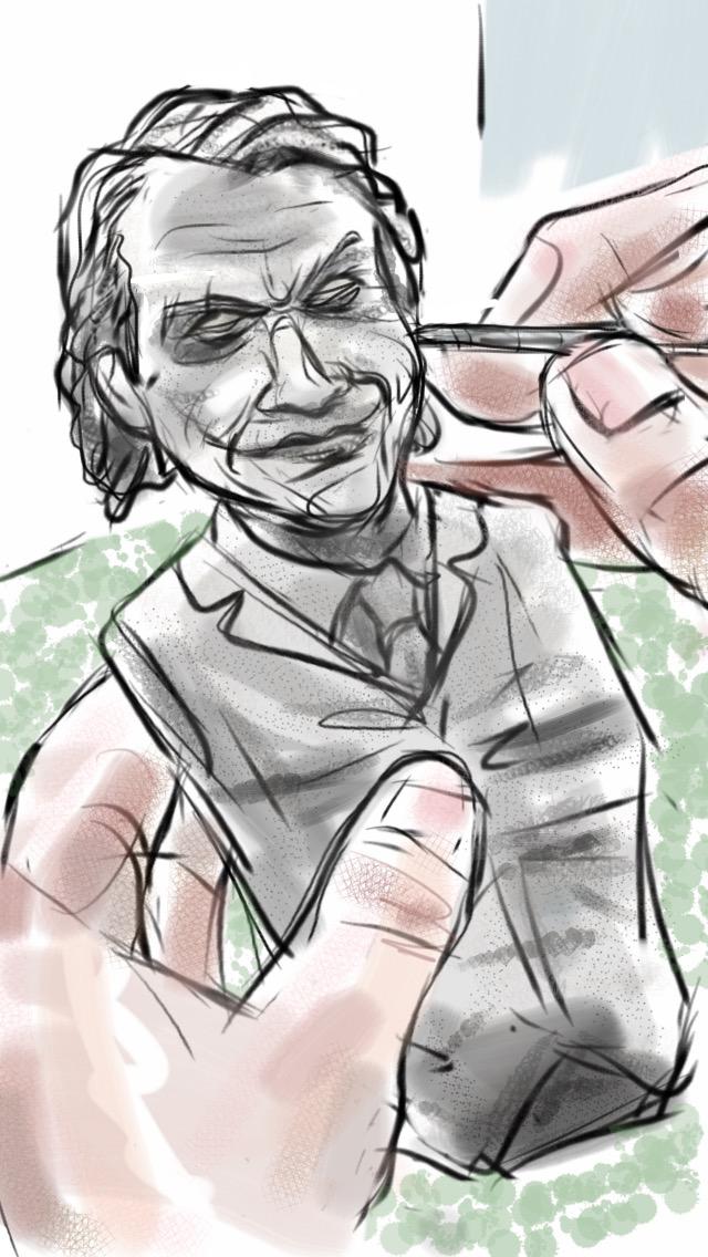 Caption: A sculptor at NECA works on a Heath Ledger/Joker action figure., Credit: Eric Molinsky