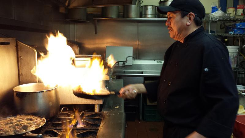 Caption: Co-owner Tony Torres cooking Shrimp a la Diabla, Credit: Olivia Cueva