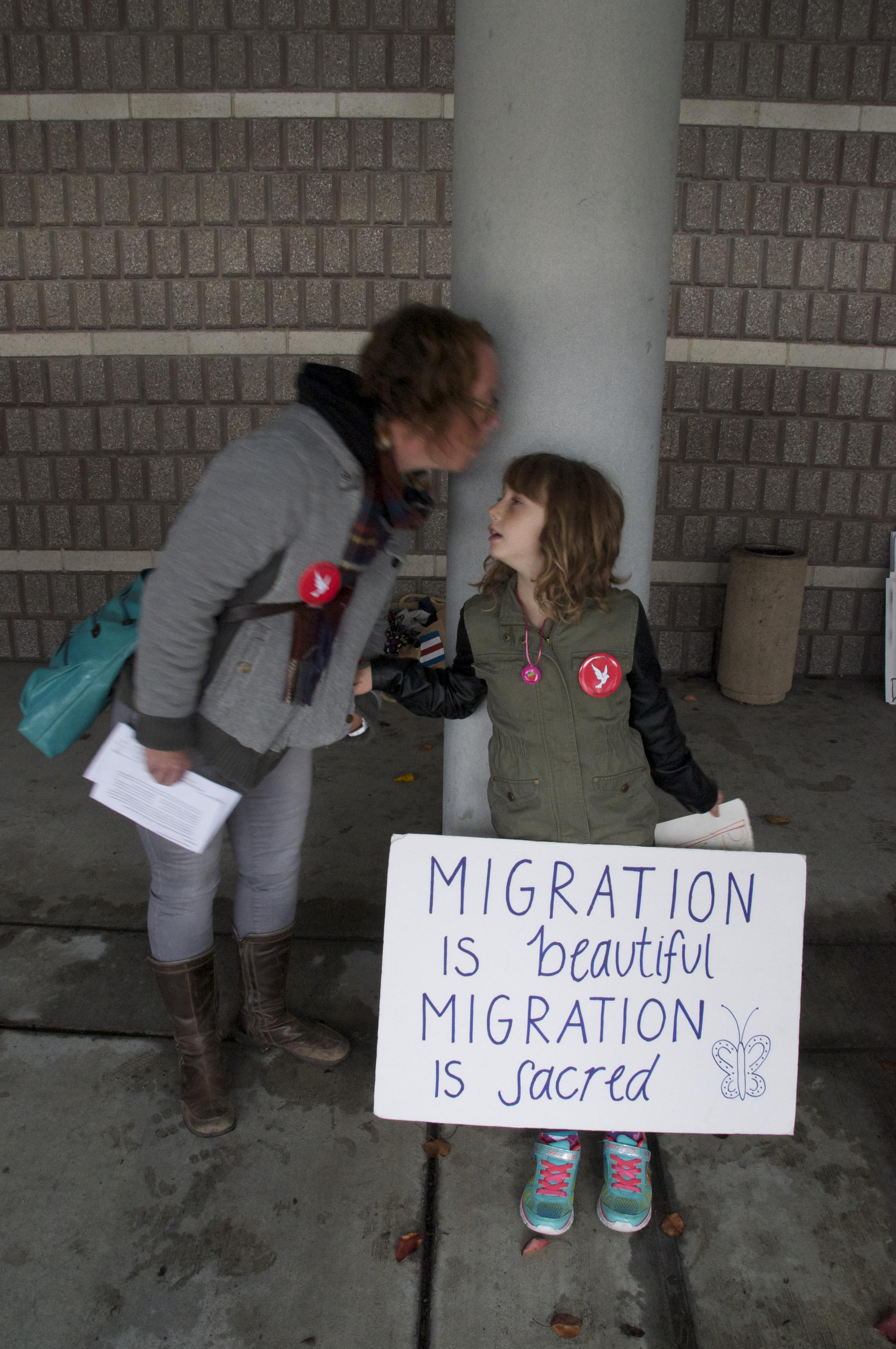 Caption: Danielle Gabriel and her daughter stand vigil outside West County Detention Facility., Credit: Photo by Stephen Southern.