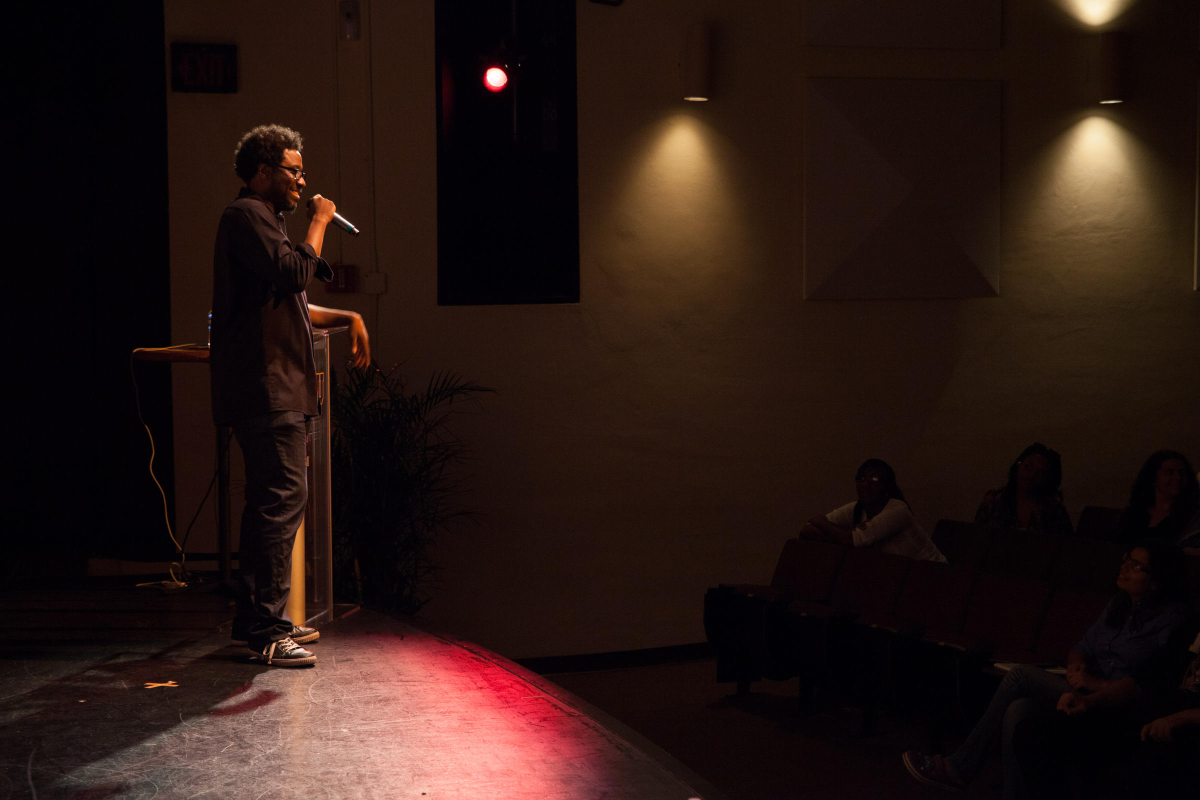 Caption: Comedian W. Kamau Bell performing his stand up act, Credit: flickr user Florida International University