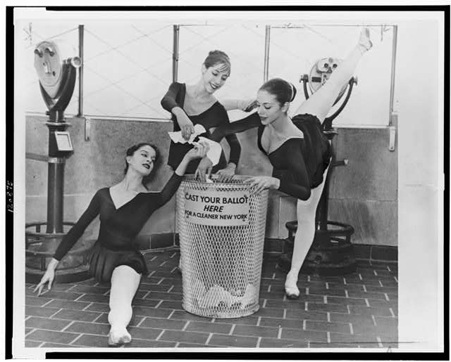 Caption: Three ballerinas perform pas de trois as they cast ballots into trash can, atop the Empire State Building., Credit: World Telegram and Sun, Library of Congress
