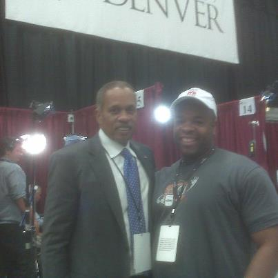 Caption: Jaun Williams and Mr. Flowe in the press pool, Credit: UC at Denver
