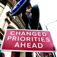 Caption: Road sign reading: Changed Priorities Ahead, Credit: Photo by Christine at Flikr