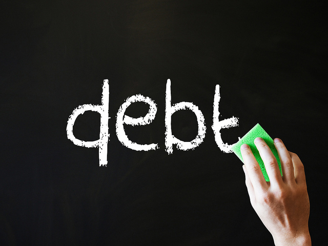 Caption: Wiping out debt, Credit: TaxRebate.org.uk