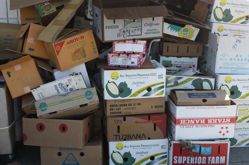 Caption: Empty produce boxes outside of Oakland's Sun Hop Fat Market, Credit: Hannah Kingsley-Ma