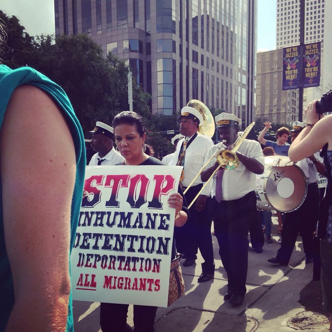 Caption: Immigrants and supporters march down Poydras Street in New Orleans on July 10., Credit: Jasmin Mara Lopez