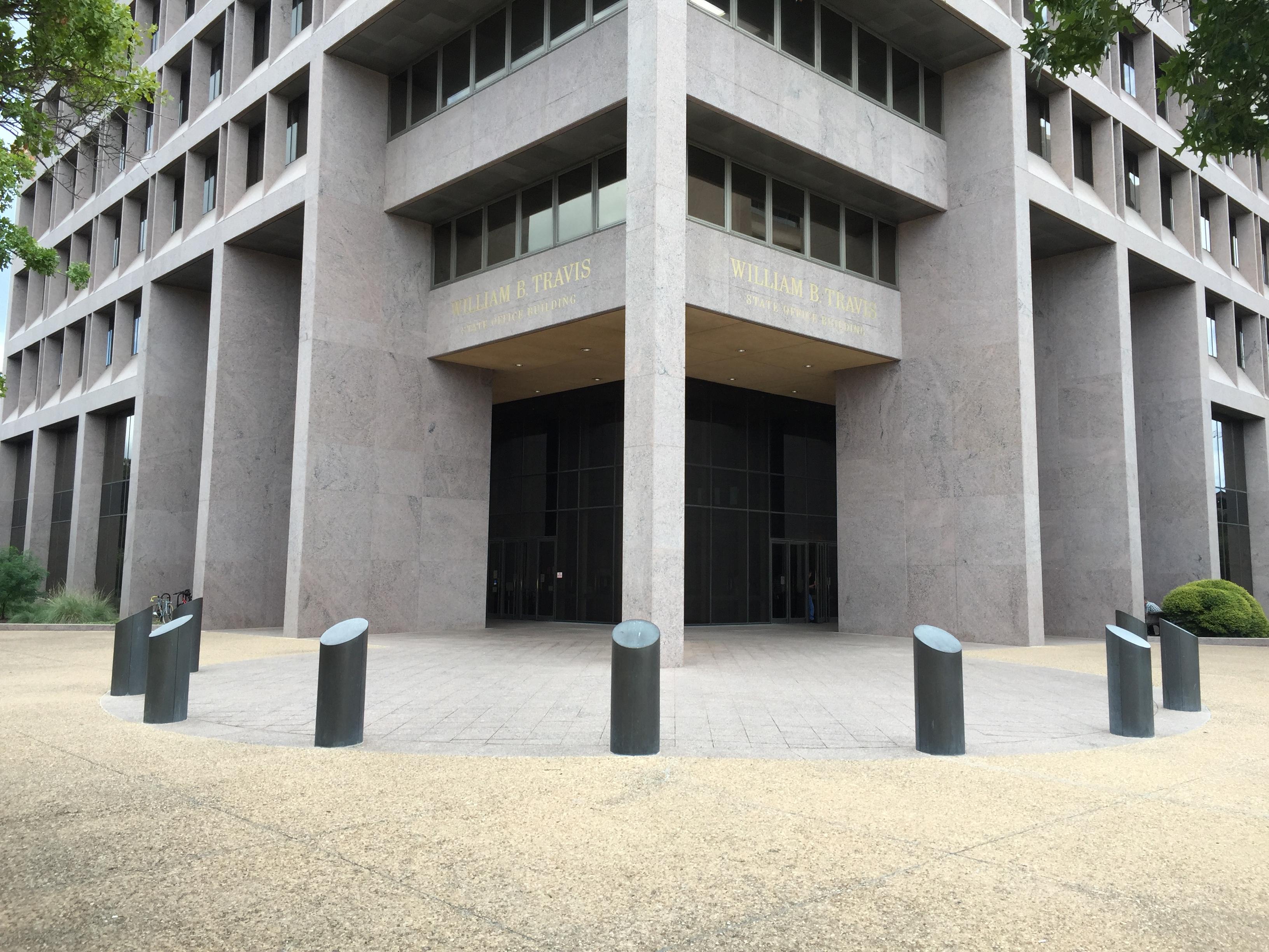 Caption: Bollards outside the William B. Travis Building, Credit: Matt Croydon
