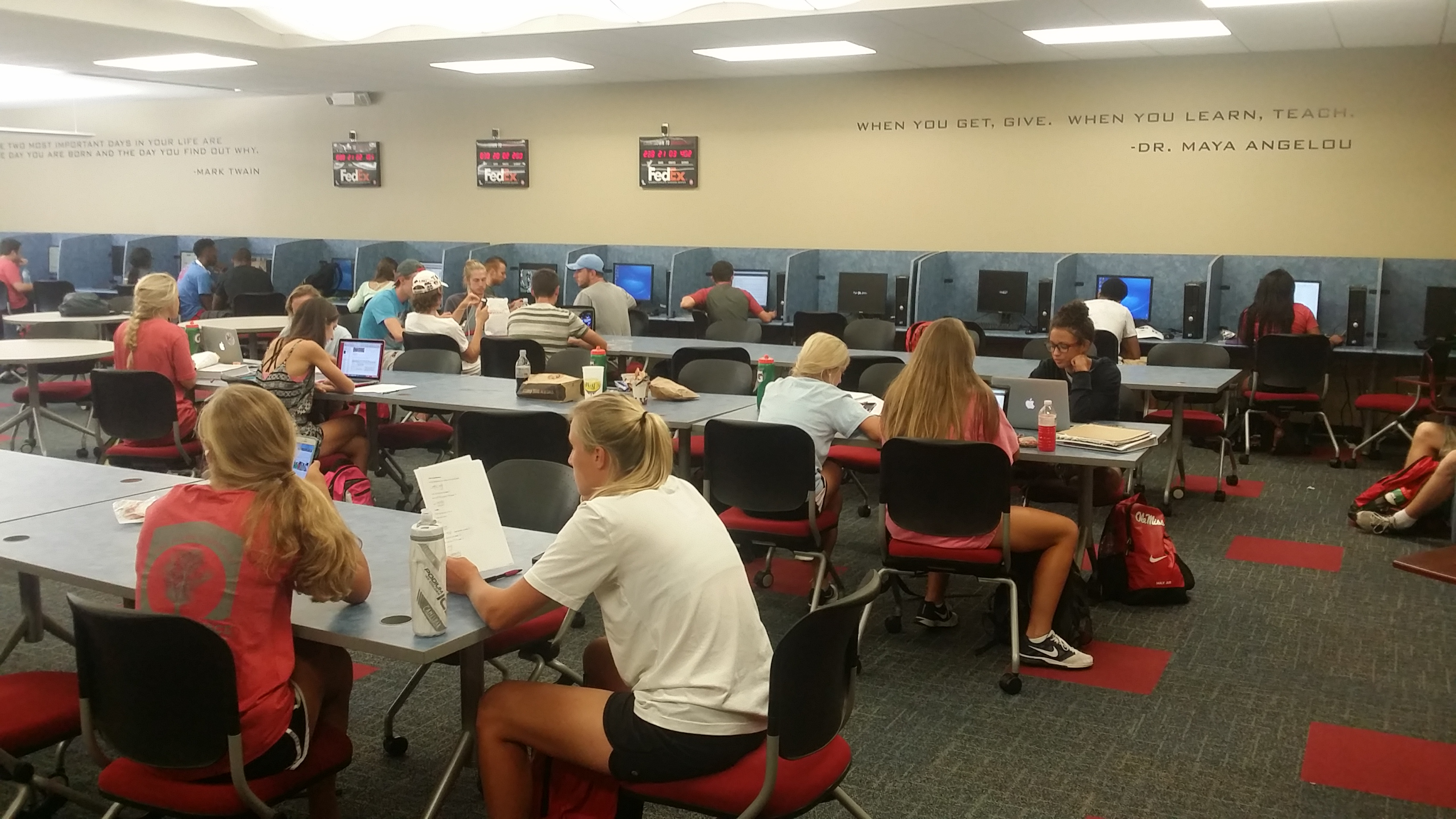 Caption: The FedEx Student-Athlete Academic Support Center is a busy place at Ole Miss, Credit: Paul Boger