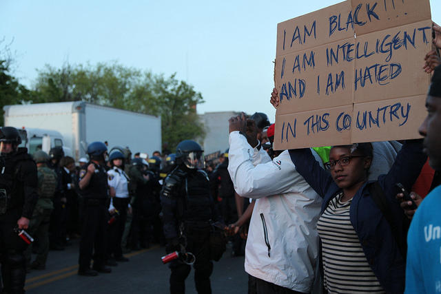 Caption: A young person demonstrating in West Baltimore on April 28th, 2015