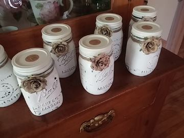 Caption: Carol creates candles and pours them into recycled Ball jars she decorates and adorns.