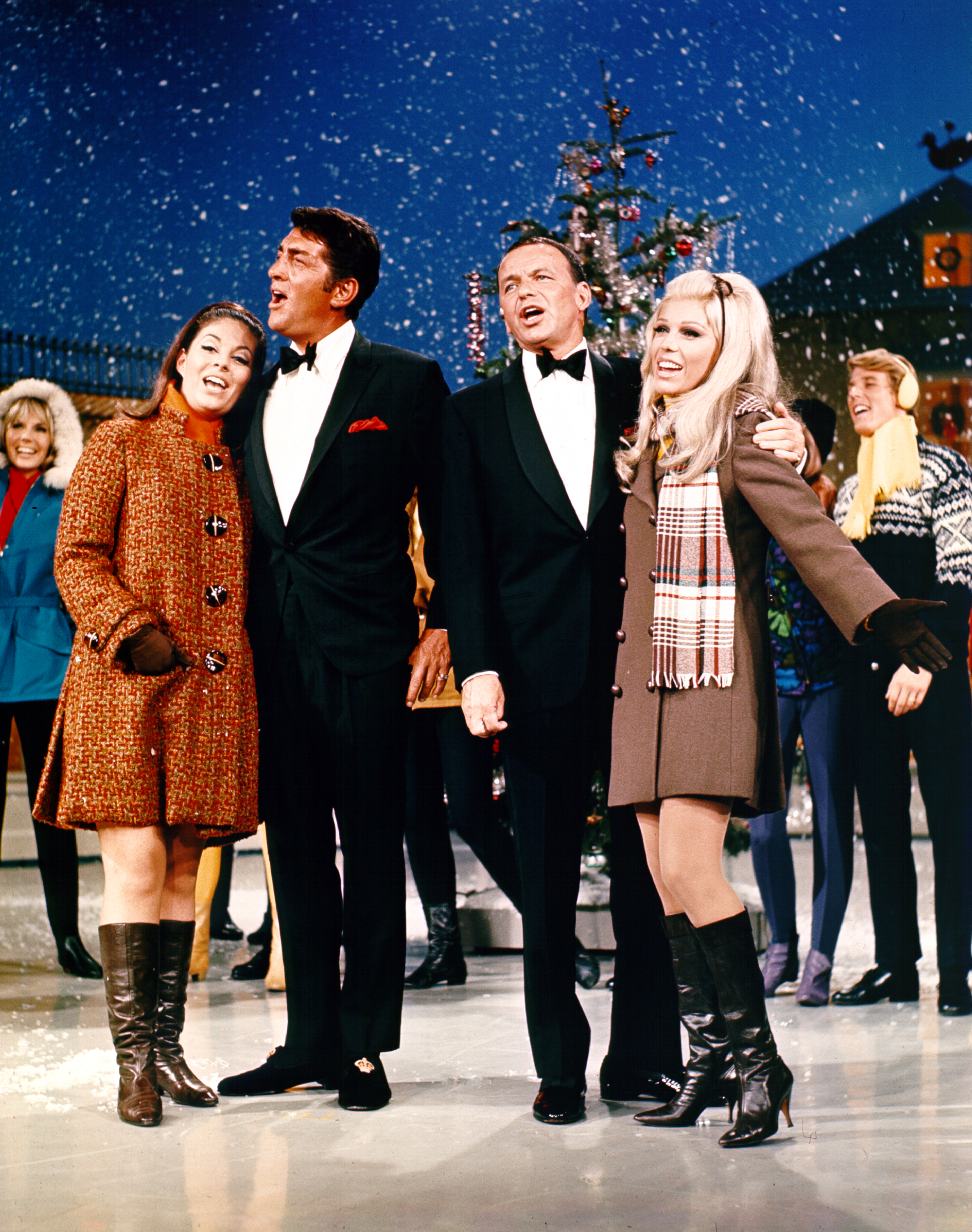 Caption: Entertainers Deana Martin, Dean Martin, Frank Sinatra and Nancy Sinatra perform on a Christmas special TV show in December 1967., Credit: Michael Ochs Archives/Stinger/Getty