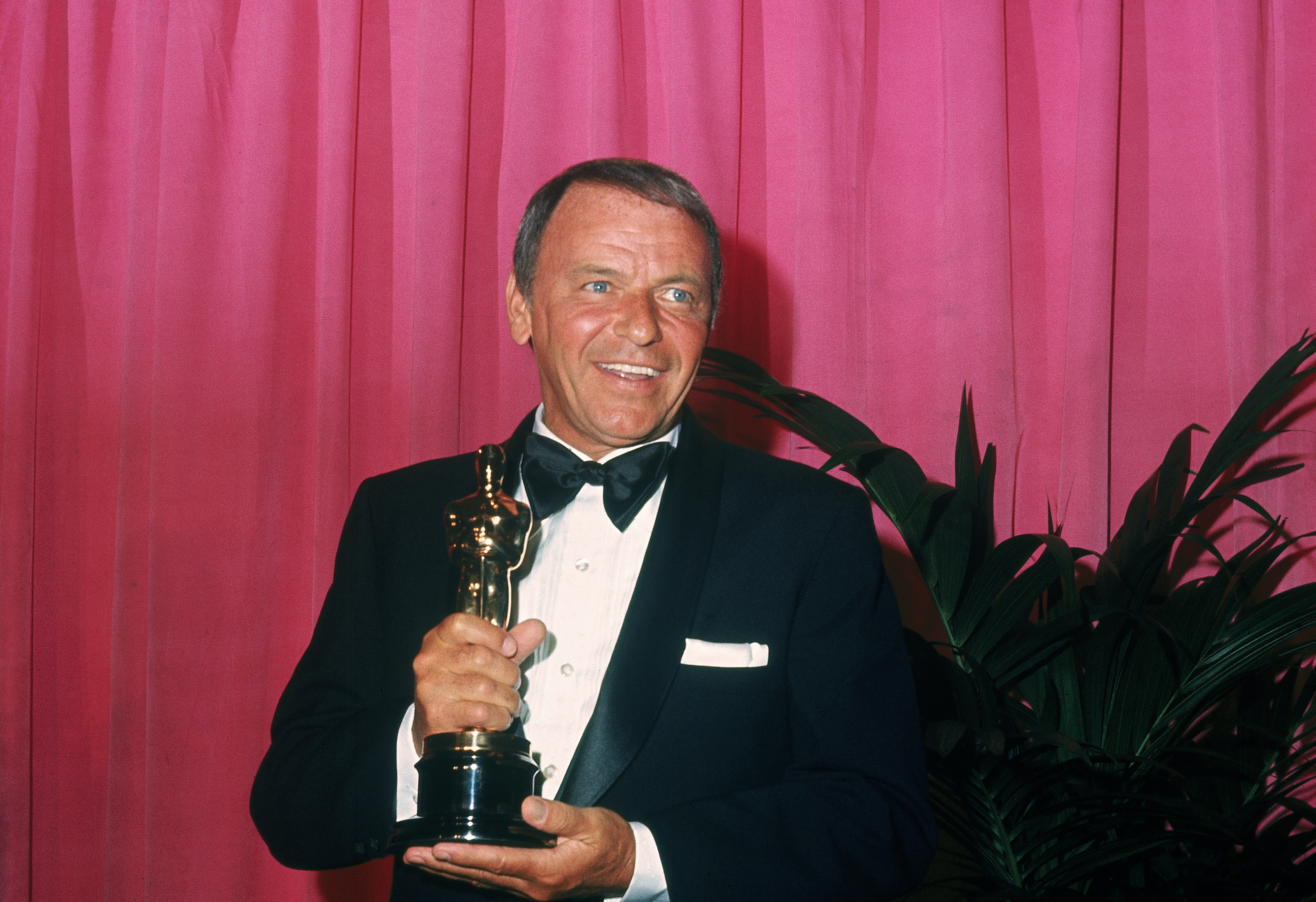 Caption: 5th April 1971: American singer and actor Frank Sinatra (1915 - 1998) holds his Jean Hersholt Humanitarian Award at the Academy Awards, Dorothy Chandler Pavilion, L.A. County Music Center, Los Angeles, Credit: Frank Edwards/Getty
