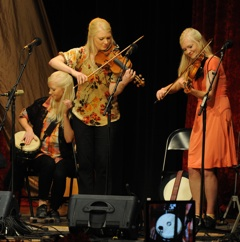 Caption: The Gothard Sisters perform on the WoodSongs Stage.