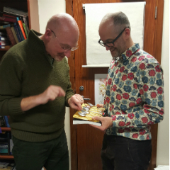 Caption: Mark Miodownik shows presenter Quentin Cooper the electroplated spoons he's used to test how different metals can affect the taste of our food., Credit: Hannah Marshall