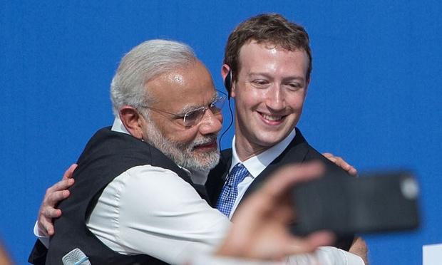 Caption: Modi and Zuckerberg
