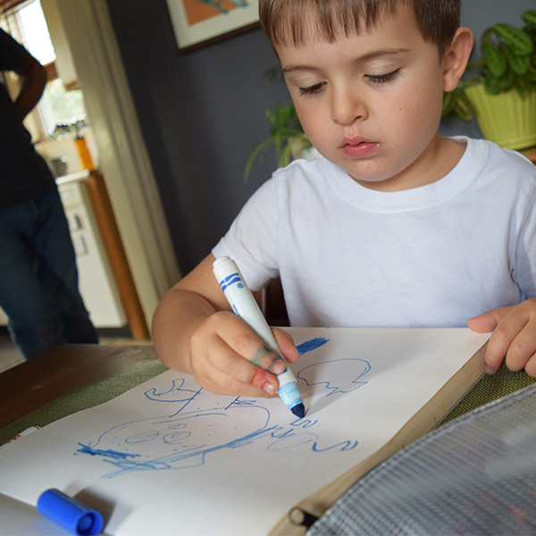 Caption: Casey draws his imaginary grandson., Credit: Pien Huang
