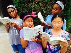 Caption: Amandla,  Imani, Angela, and Eunhea, readers from Robert Goddard Montessori School, Grace Christian School, Fairhaven School, and St. Anne's School – all in Maryland.