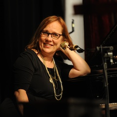Caption: Iris DeMent on the WoodSongs Stage.