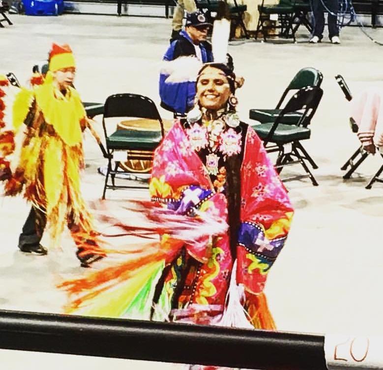 Caption: A fancy shawl dancer makes her way around the arena floor., Credit: Heidi Holtan