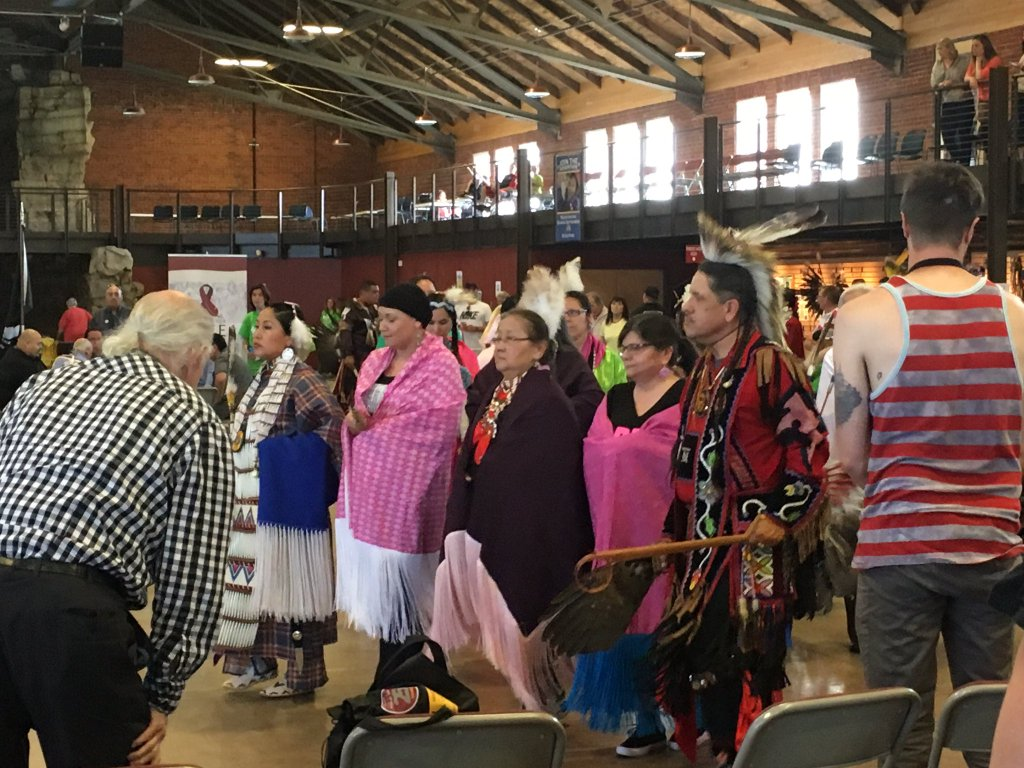Caption: People gather for the Pink Shawls Honor Song at the Pow Wow for Hope in Minneapolis., Credit: American Indian Cancer Foundation