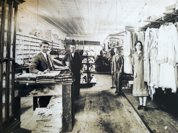 Caption: Historical photo is of Penny Rosenwasser's granddaddy Moishe's (far left) dry goods store in Denmark, SC in the 1930s-40s.