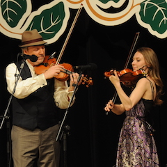 Caption: Mark O'Connor with wife Maggie on the WoodSongs Stage.