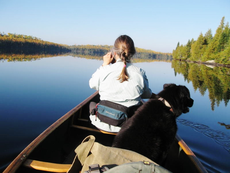 Caption: Traveling by canoe with Maggie, the dog