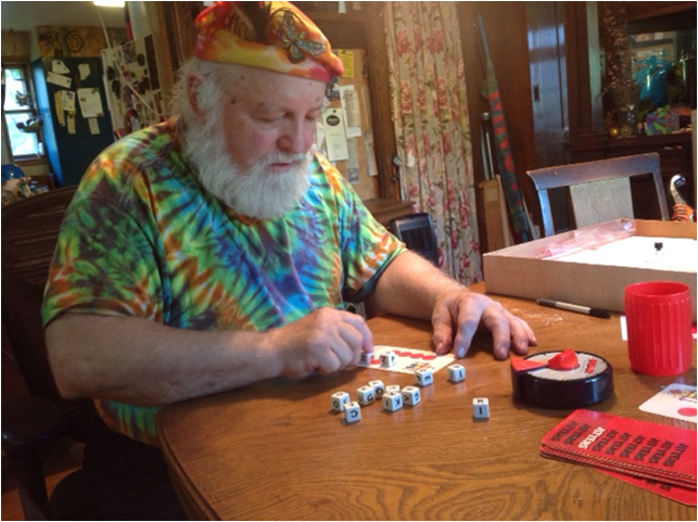 Caption: Richard Tatge plays one of his 6,000 board games., Credit: Emily Bright