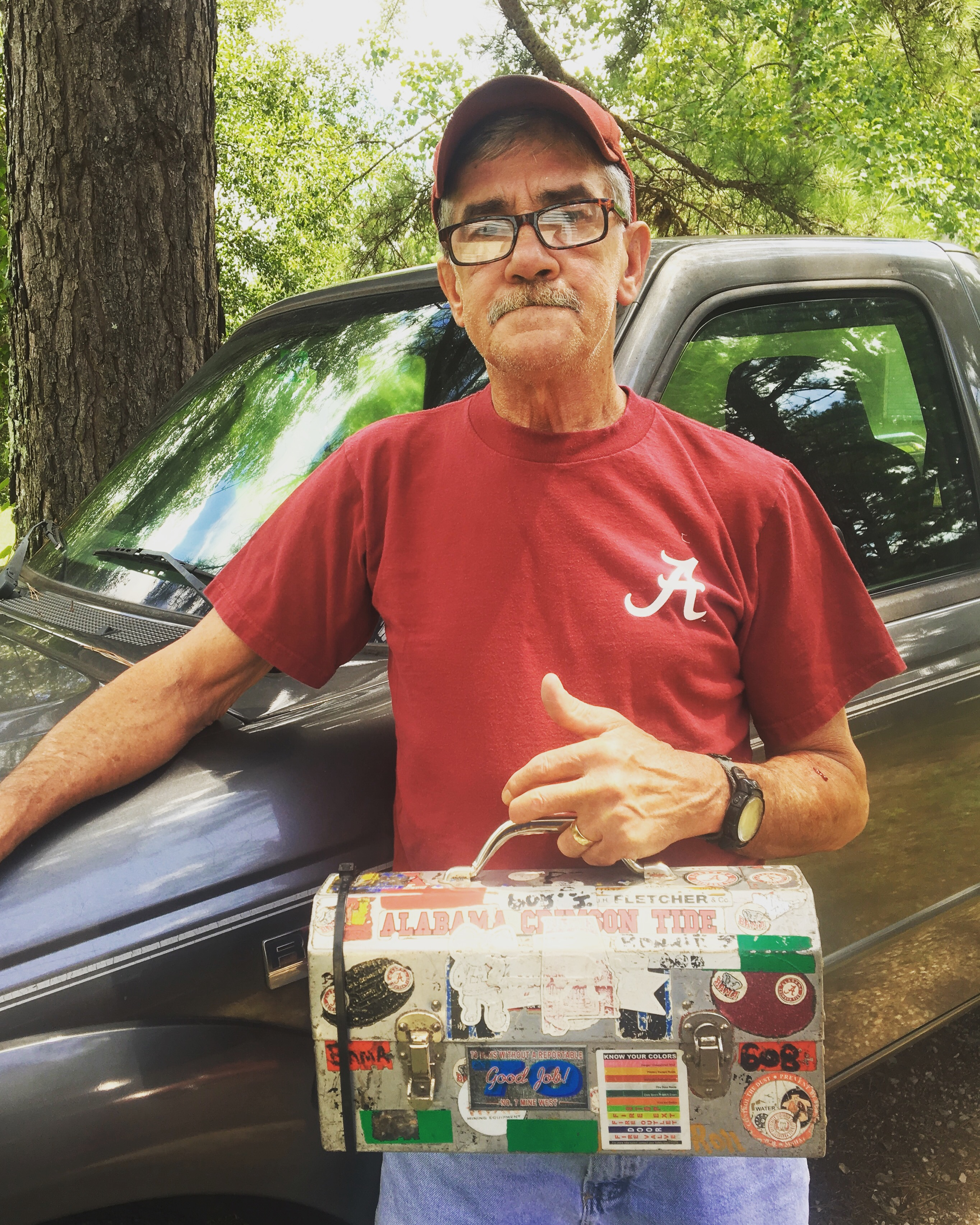 Caption: Coal miner Ronnie Johnson, with his lunchbox.