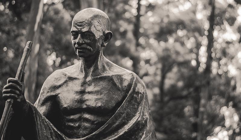 Caption: A statue of Mahatma Gandhi
