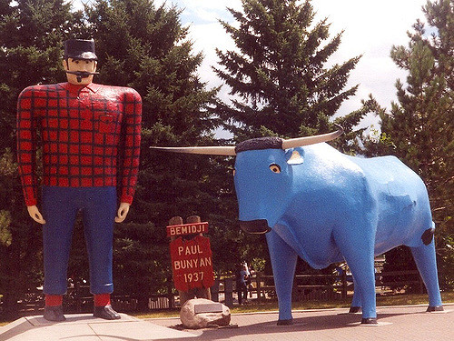 Caption: Paul Bunyan and Babe the Blue Ox stand on the shores of Lake Bemidji.