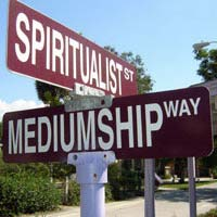 Caption: Cassageda crossroads sign: Spiritualist St and Mediumship Way, Credit: photo: Rachael Anne Ryals