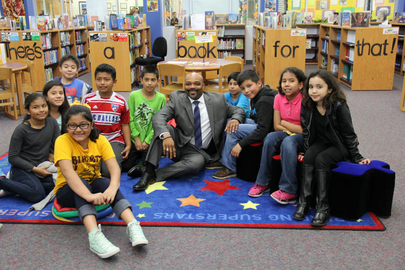 Caption: Duncanville Superintendent Marc Smith surrounded by students , Credit: Bill Zeeble