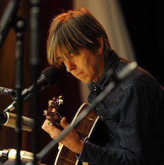 Caption: Guitar master Eric Johnson on the WoodSongs stage.