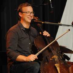 Caption: Ben Sollee on the WoodSongs Stage.