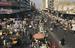 Caption: Market stands line Baghdad street., Credit: Associated Press