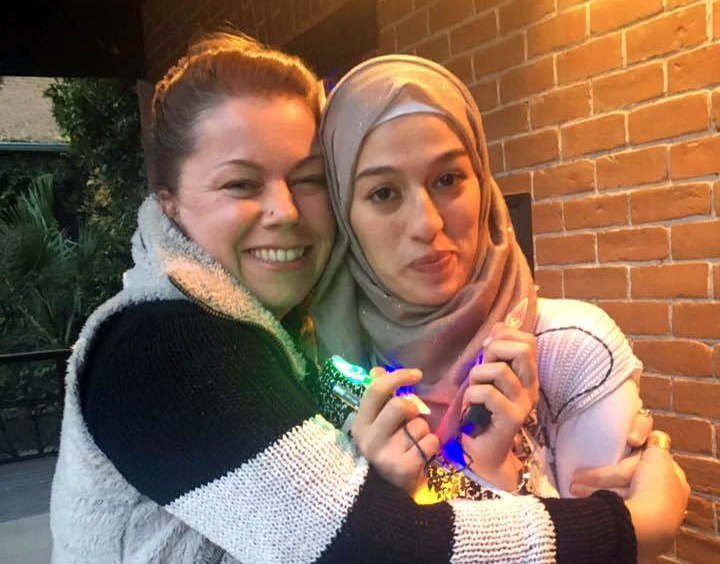 Caption: Houda and Melanie on KXCI's front porch. , Credit:  Photo by episode 1 translator, Radwa Abdel-Barry.