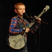 Caption: WoodSongs Kid Kevin Beddingfield delivers a fiery performance.