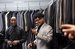 Caption: Kimball High School Academy of Hospitality and Tourism students are fitted with suits to interview in while on a field trip to Workforce Solutions Greater Dallas., Credit: Lara Solt