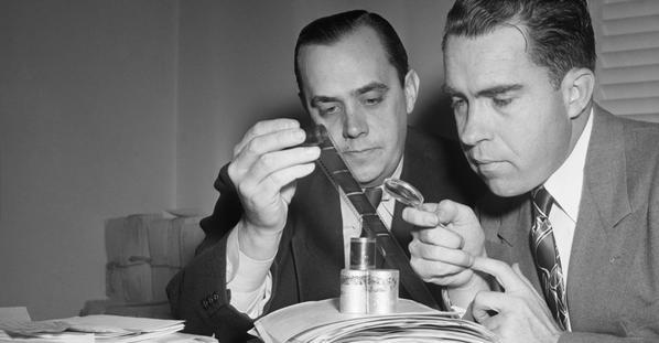 Caption: Congressman Nixon & Robert Stripling examine Pumpkin Papers microfilm
