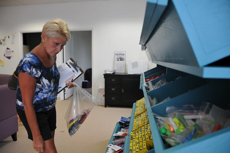 Caption: Guilford County fourth grade math teacher Diana Watson scopes out the shelves of donated markers and highlighters at the Guilford County Teacher Supply Warehouse., Credit: Jess Clark, WUNC