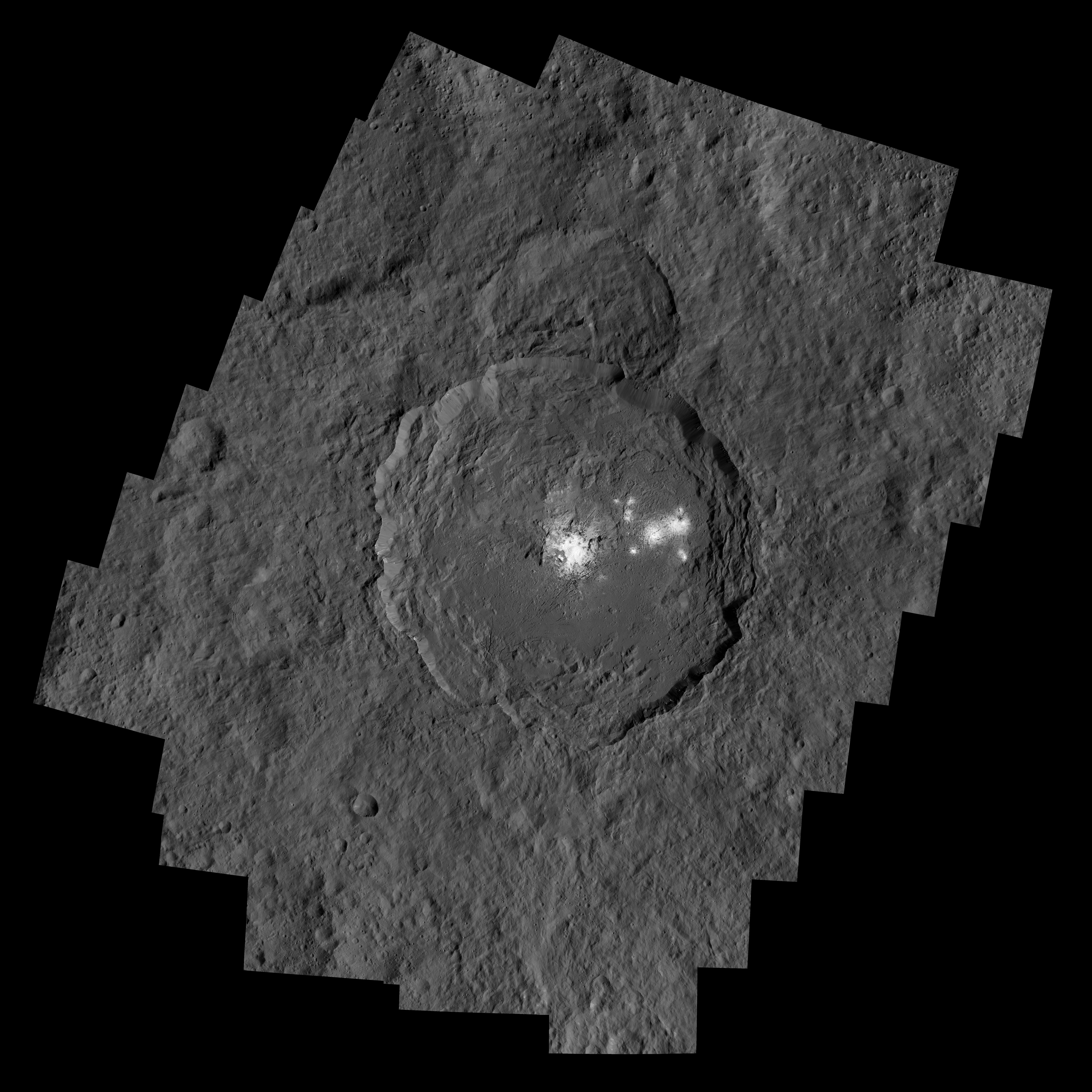 Caption: Occator Crater on dwarf planet Ceres, with its now less mysterious bright spots or areas., Credit: NASA/JPL-Caltech/UCLA/MPS/DLR/IDA/PSI