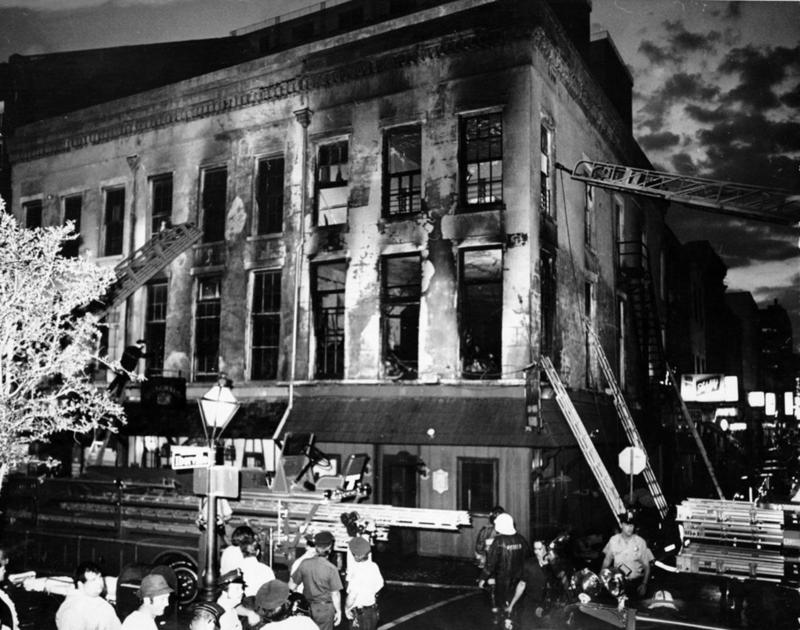Caption:  Exterior of the UpStairs Lounge after the fire.