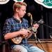 Caption: WoodSongs Kid Felix Sparling and his ukulele.