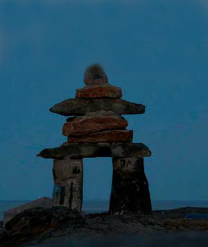"Caption: Inukshuk in Rankin Inlet, Nunavut, Canada. Inukshuk are stone structures constructed to communicate with humans throughout the Arctic. Traditionally constructed by the Inuit, the word means ""to act in the capacity of a human."""