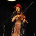 Caption: Phoebe Hunt on the WoodSongs Stage.