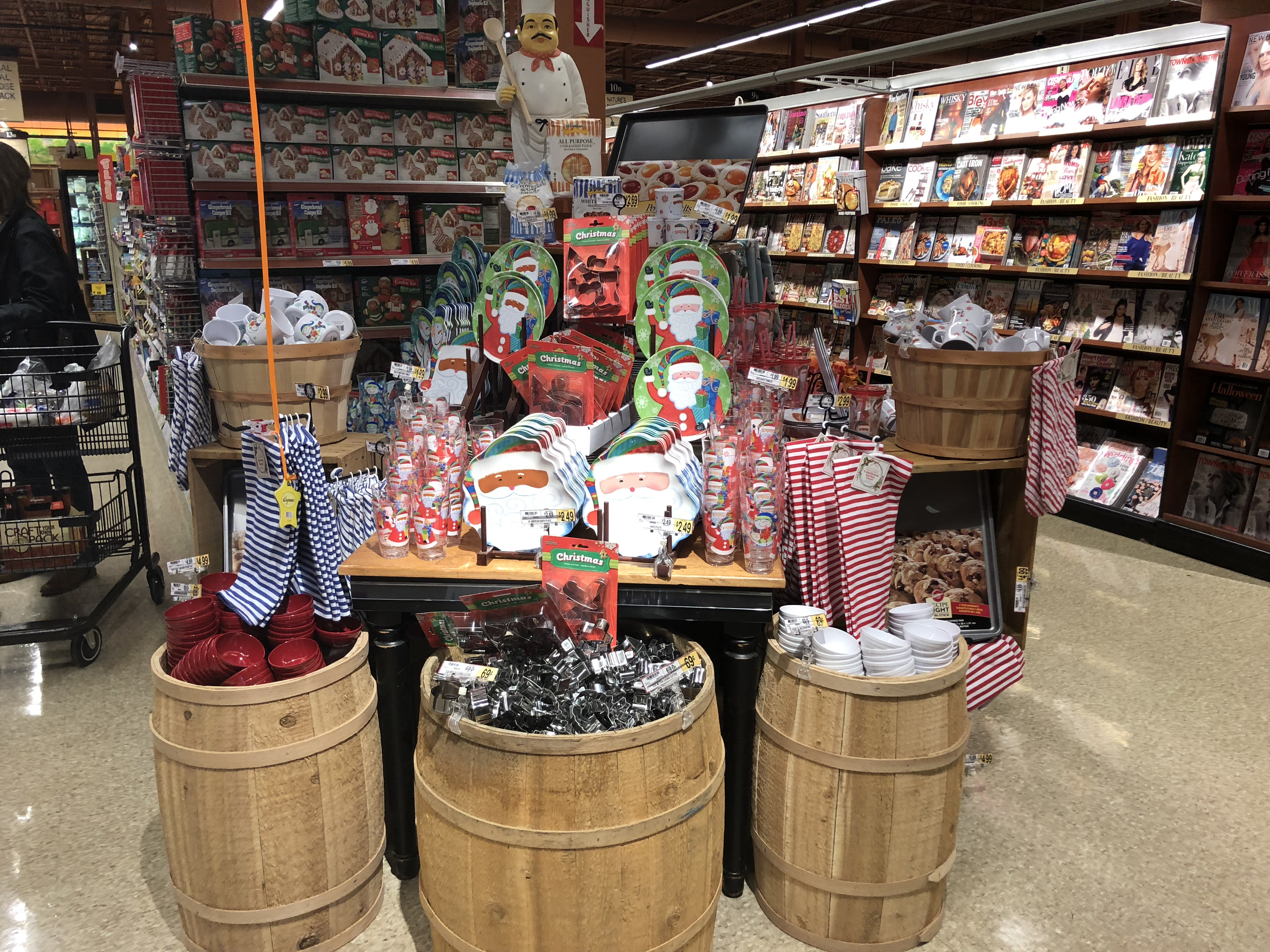 Caption: A Christmas display, the one referred to in the audio piece, in a grocery store on October 27th. , Credit: Emma Henzes