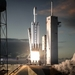 Caption: Artist concept of SpaceX Falcon Heavy launch., Credit: SpaceX